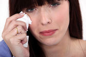 Woman crying with a tissue — Stock Photo