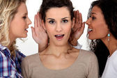 Women whispering to each other — Stock Photo