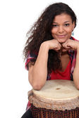 Woman sat with bongo — Stock Photo