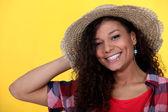 Brunette wearing straw hat — Stock Photo