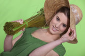 Oblique portrait of woman with straw hat — Stock Photo
