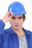 A construction worker saluting. — Foto Stock