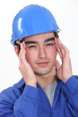 Builder suffering from headache — Stock Photo