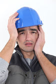 Craftsman holding his head — Stock Photo