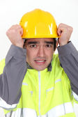 Construction worker protecting his head — Stock Photo