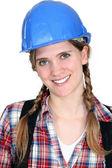 Portrét smějící se tradeswoman — Stock fotografie