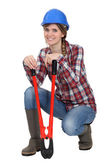 Tradeswoman holding oversized pliers — Stock Photo