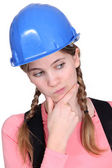 Portrait of female apprentice looking puzzled — Stock Photo