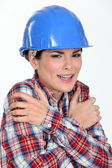 Scared female builder — Stock Photo