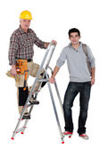 Builder stood on ladder next to apprentice — Stock Photo