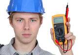 Man holding electrical current reader — Stock Photo