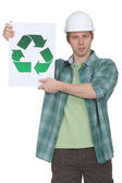 A construction worker promoting recycling. — Stock Photo