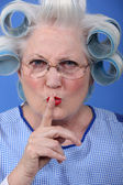 Woman with curlers for silence — Stock Photo