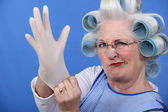 Senior woman with hair curlers — Stock Photo