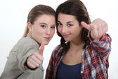 Thumbs up from two friends — Stock Photo
