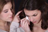 Young woman consoling a friend — Stock Photo
