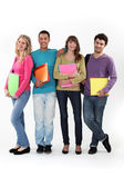 Four university students with folders — Stock Photo