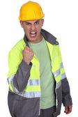 Aggressive construction worker rejoicing — Stock Photo