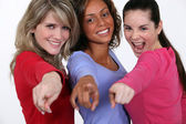 A group of young women pointing their fingers — Stock Photo