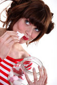 Woman eating candy — Stock Photo
