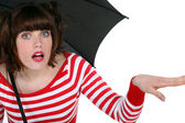 Shocked woman under an umbrella — Stock Photo