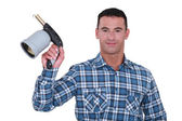 Man showing blowtorch on white background — Stock Photo