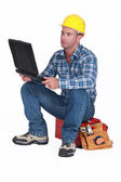 Tradesman checking his emails — Stock Photo