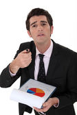 Expressive businessman with graph — Stock Photo