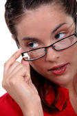 Woman seductively removing glasses — Stock Photo
