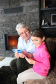 Grandfather and granddaughter playing cards — Stock Photo