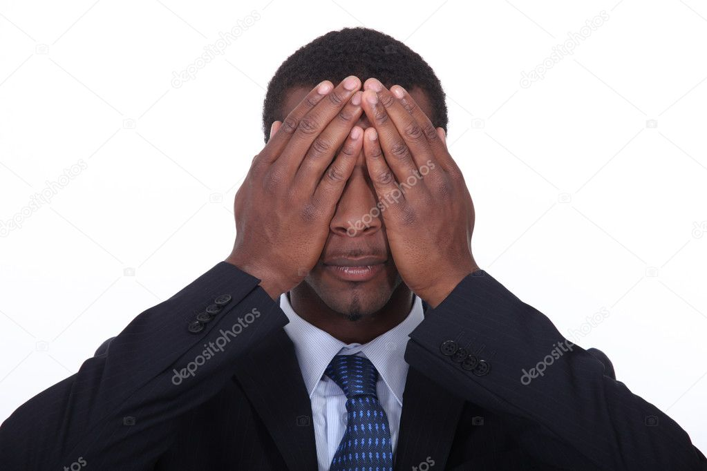 Black man putting hands on his eyes — Stock Photo #10492939