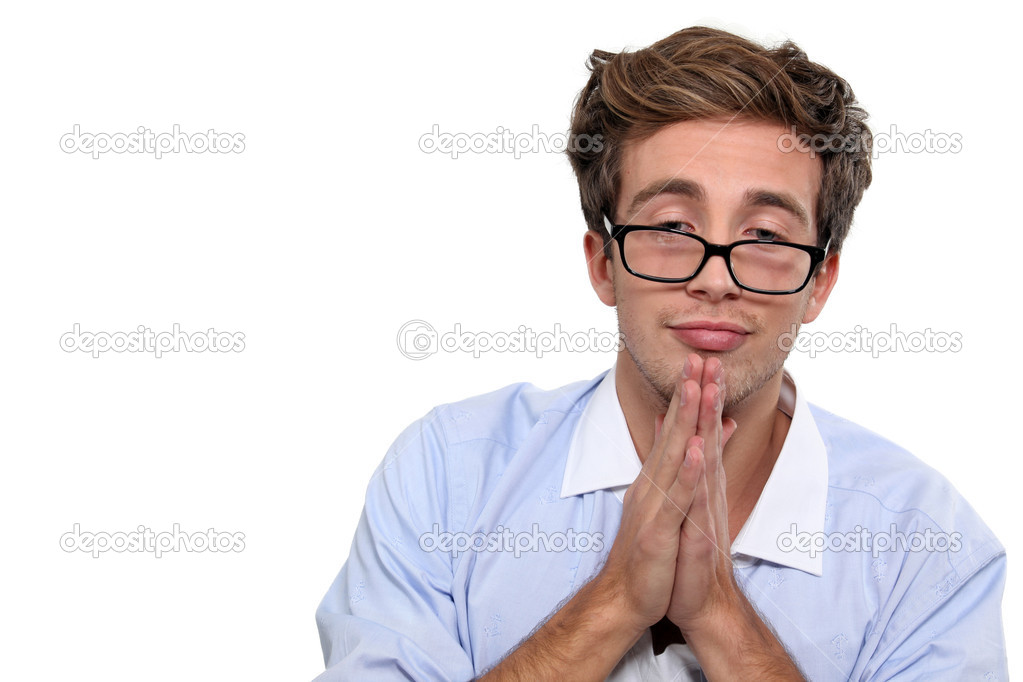 Geeky young man praying  Stock Photo #10493953