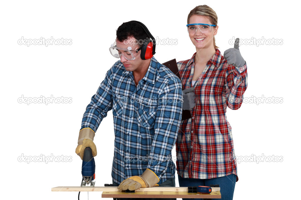 Woman inspecting carpenter — Stock Photo #10497973