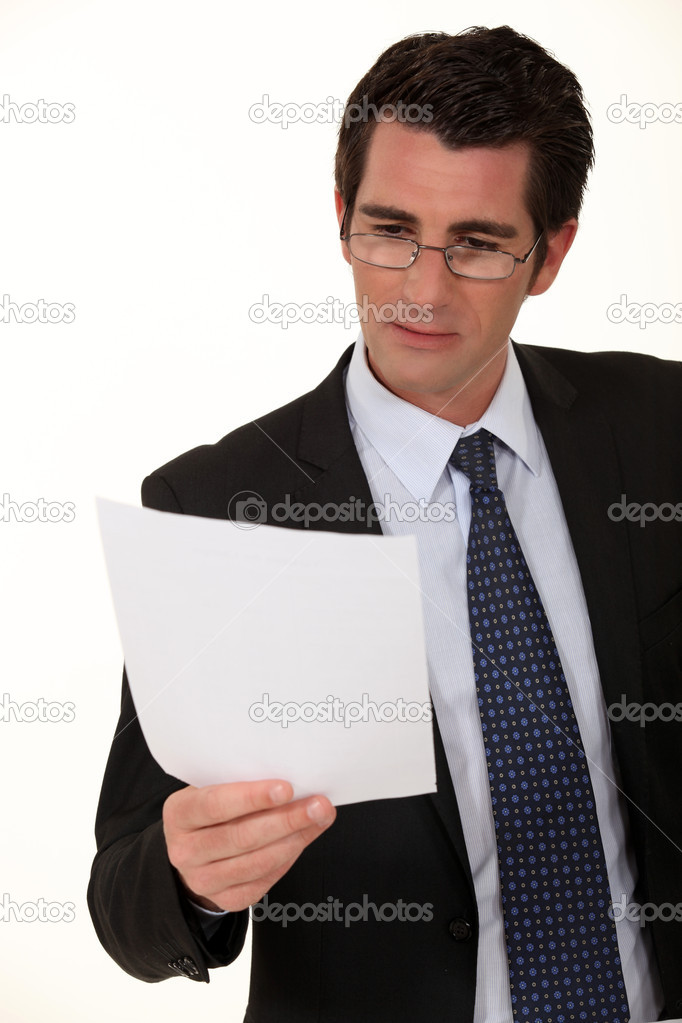 Businessman reading a document — Stock Photo #10498652