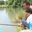 Father and son fishing together — Stock Photo #10500358