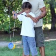 Father playing with son with a diabolo - Stock Photo