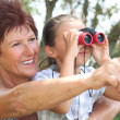 Grandmother with granddaughter and binoculars — Stock Photo #10500437