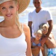 Parents with children on the beach — Stock Photo