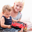 Mother with baby and car — Stock Photo
