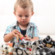 Stock Photo: Little boy playing with toys