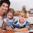 Parents with young children - Stock Photo
