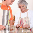 Grandmother and grandson in the kitchen — Stock Photo