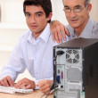 Grandfather and grandson with computer — Stock Photo