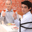 Grandfather and grandson toasting with wine — Stock Photo