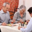 Grandparents and grandson at restaurant — Stock Photo