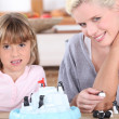 Mother and daughter playing at home — Stock Photo