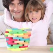 Father with daughter and puzzle — Stock Photo