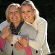 Grandmother and granddaughter hugging — Stock Photo #10502048