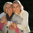 Grandmother and granddaughter hugging — Foto Stock #10502048