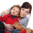 Mother sat with boy and teddy bear — Stock Photo